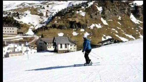 Marjolein skiing down Passo Rolle II