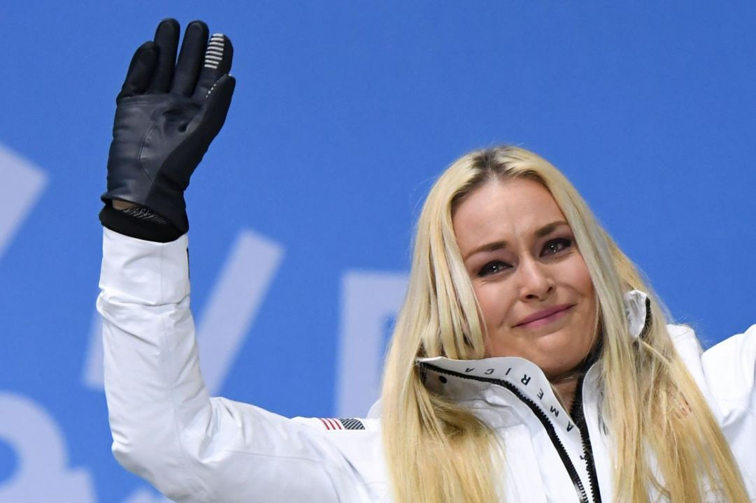 USA's bronze medallist Lindsey Vonn tears up on the podium during the medal ceremony for the alpine skiing Women's Downhill at the Pyeongchang Medals Plaza during the Pyeongchang 2018 Winter Olympic Games in Pyeongchang on February 21, 2018. / AFP PHOTO / JAVIER SORIANO