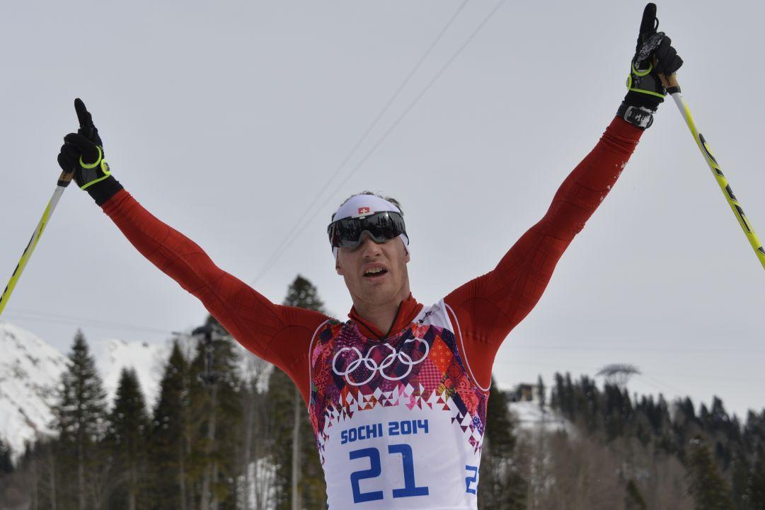 Dario Cologna vince l'oro olimpico nello skiathlon